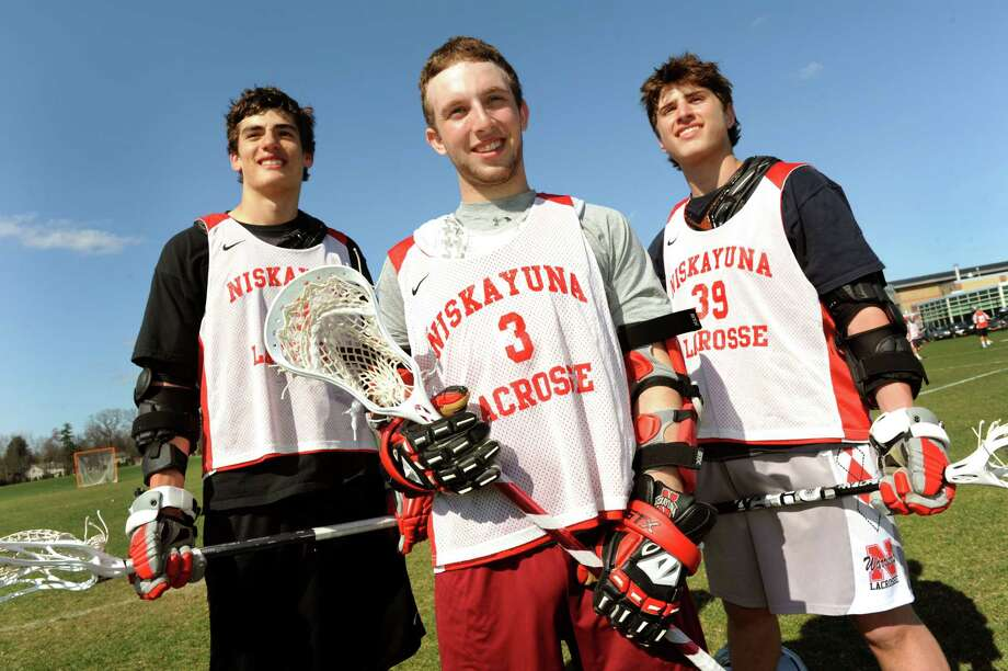 Niskayuna's lacrosse players Luke Goldstock, let, Lucas Maloney, center, and Mike D'Amario on Thursday, April 25, 2013, at Niskayuna High in Niskayuna, N.Y. (Cindy Schultz / Times Union) Photo: Cindy Schultz / 10022079A