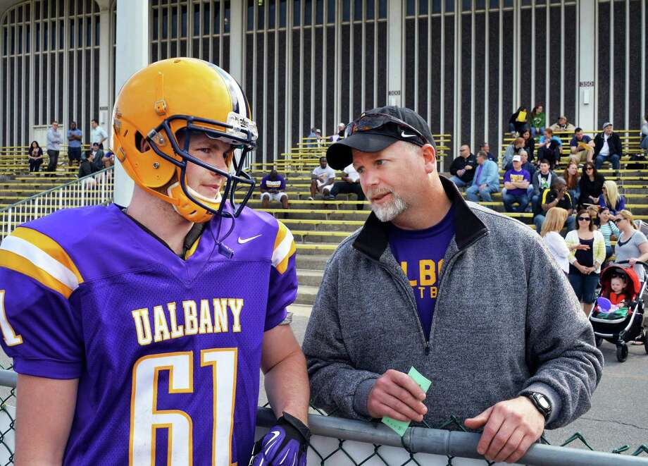 UAlbany punter #61 Jon Martin chats with his father Dave Martin during halftime at UAlbany football's annual Spring Game to conclude spring football practice at University Field in Albany, NY Saturday April 27, 2013.  (John Carl D'Annibale / Times Union) Photo: John Carl D'Annibale / 10022160A