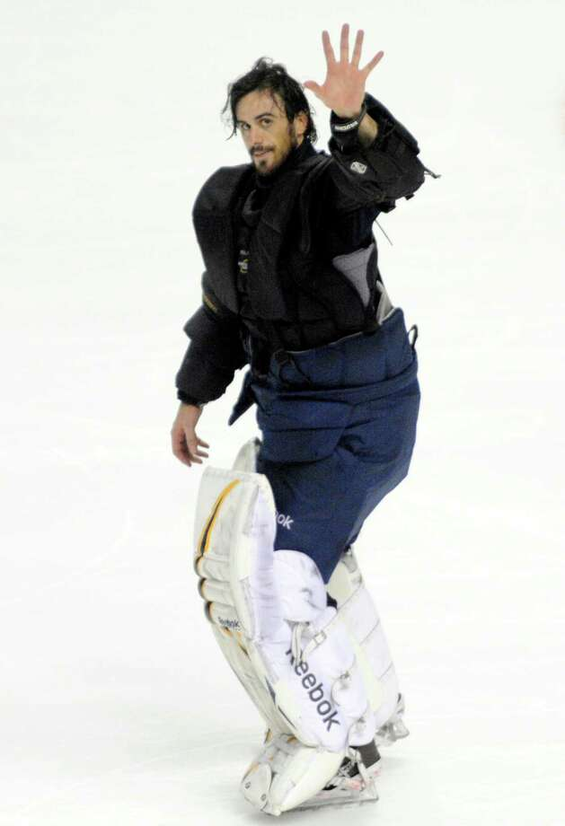 Buffalo Sabres goaltender Ryan Miller waves to the crowd after an NHL hockey game against the New York Islanders in Buffalo, N.Y., Friday, April 26, 2013. Miller, who started his 500th NHL game, helped the Sabres beat the Islanders, 2-1. (AP Photo/Gary Wiepert) Photo: Gary Wiepert