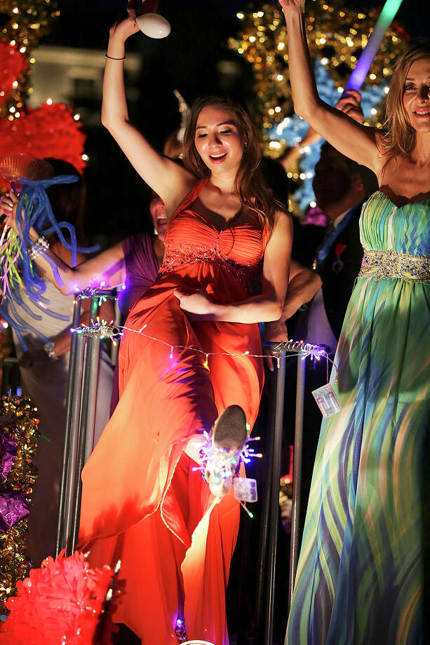 the Flambeau Parade moves toward the downtown area  on  April 27 2013. Photo: Tom Reel, San Antonio Express-News