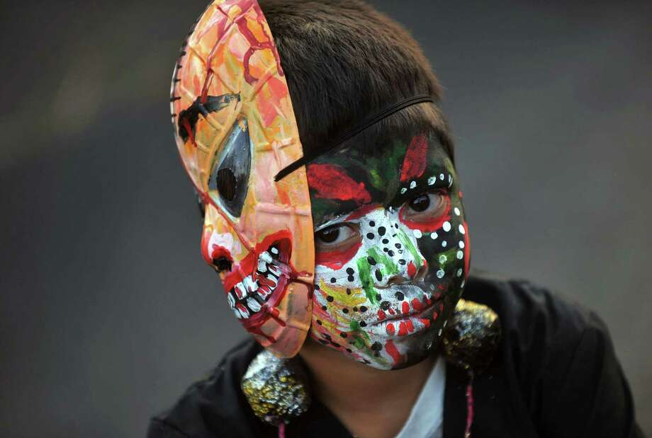 "A boy attends the ""Joy for Life Carnival""(Carnaval Alegria por la Vida), in Managua on April 27, 2013. AFP PHOTO/Hector RETAMAL Photo: HECTOR RETAMAL, AFP/Getty Images / AFP"