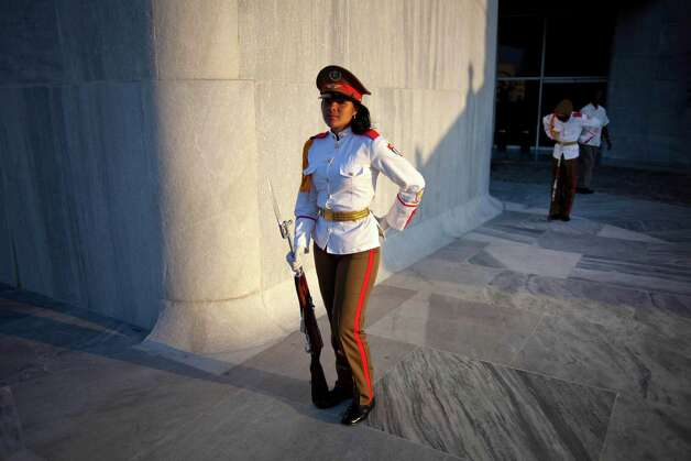 Cuban soldiers wait for the arrival of Venezuela's President Nicolas Maduro, before a wreath-laying ceremony at the Jose Marti monument in Havana, Cuba, Saturday, April 27, 2013. (AP Photo/Ramon Espinosa) Photo: Ramon Espinosa, Associated Press / AP