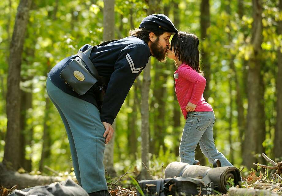 Brian Mitchell kisses his six-year-old daughter Cailin before joining other re-enactors depicting the 28th Massachusetts Company during the official opening of the Stafford Civil War Park on Mt. Hope Church Road in Stafford County, Va. on Saturday, April 27, 2013. The park is situated on the site of 1863 winter encampments and fortifications of the Union Army's 11th Corps, 1st and 3rd Divisions, following the December 1862 Battle of Fredericksburg.  Photo: Peter Cihelka, Associated Press