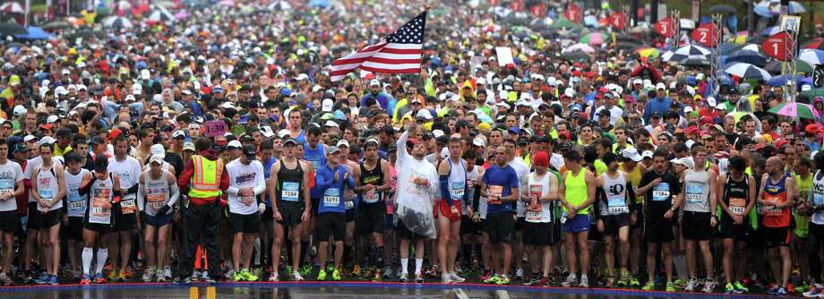 Runners take a moment of silence for those injured and killed in the Boston Marathon bombings before the start of the Country Music Marathon, Saturday, April 27, 2013 in Nashville, Tenn. (AP Photo/The Tennessean, Shelley Mays) Photo: Shelley Mays, Associated Press / The Tennessean