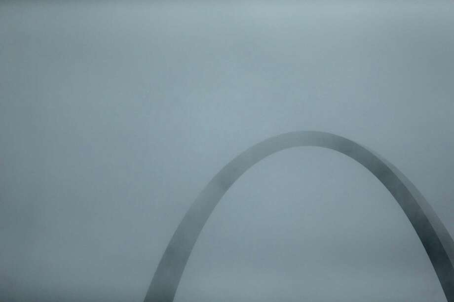 Fog surrounds the Gateway Arch during during a baseball game between the St. Louis Cardinals and the Pittsburgh Pirates Saturday, April 27, 2013, in St. Louis. (AP Photo/Jeff Roberson) Photo: Jeff Roberson, Associated Press / AP