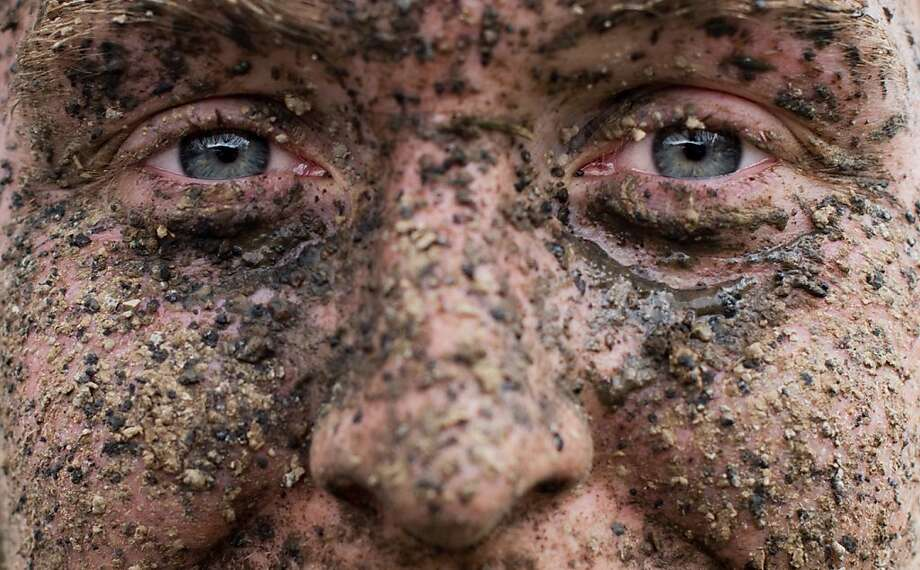 A mountain biker with his dirty face smiles in the finish area of the mountain bike festival 'Mega-Sports' in Sundern-Hagen, northwestern Germany, Saturday, April 27, 2013. 1,600 professional and amateur cyclists competed in the mountain bike marathon distances of 30 or 100 kilometers.  Photo: Julian Stratenschulte, Associated Press
