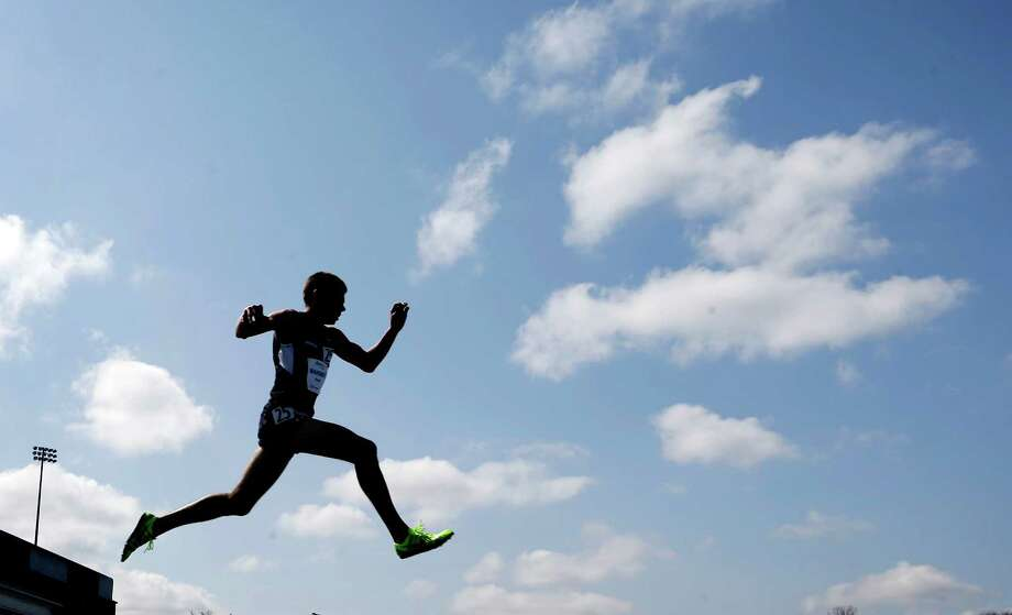 United States' Travis Mahoney clears the final hurdle during the men's 3,000-meter steeplechase at the Drake Relays athletics meet, Saturday, April 27, 2013, in Des Moines, Iowa. (AP Photo/Charlie Neibergall) Photo: Charlie Neibergall, Associated Press / AP
