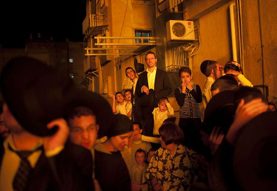 Ultra-Orthodox Jews  looks at bonfires during Lag Ba'Omer celebrations to commemorate the end of a plague said to have decimated Jews in Roman times, in Bnei Brak near Tel Aviv, Israel, Saturday, April 27, 2013. Photo: Ariel Schalit, Associated Press