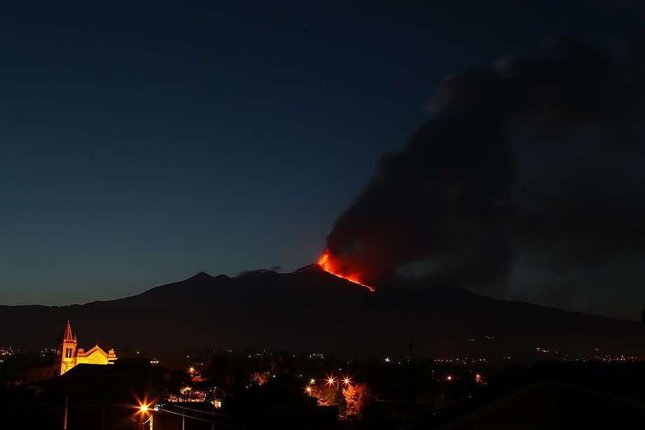 Lava flows during an eruption of Mt. Etna volcano as seen from the village of Acireale, near the Sicilian town of Catania, Italy, Saturday, April 27, 2013.  Photo: Carmelo Imbesi, Associated Press
