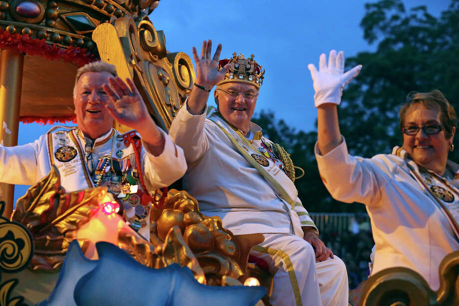 Rey Feo, Larry Benson, Sr., waves as the Flambeau Parade moves toward the downtown area  on  April 27 2013. Photo: TOM REEL, San Antonio Express-News