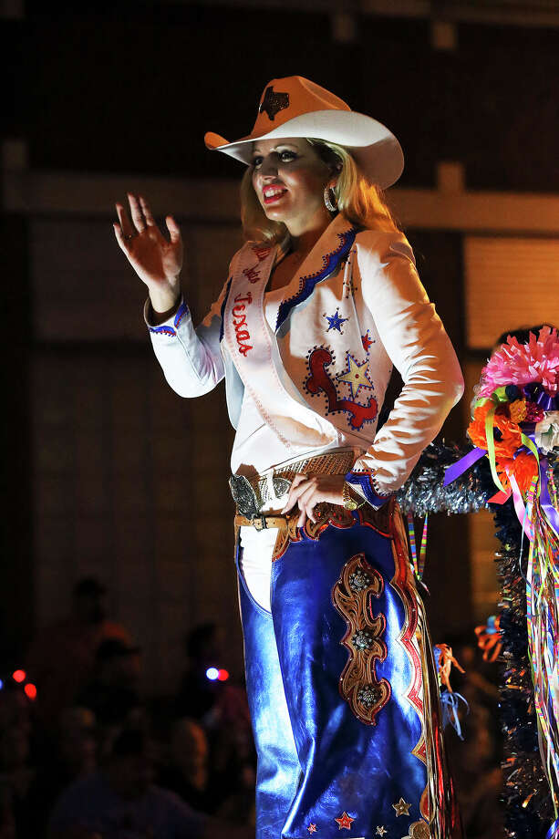 Miss Rodeo Texas, Rosanna Pace,  enjoys the crowd on Broadway as the Flambeau Parade moves toward the downtown area  on  April 27 2013. Photo: TOM REEL, San Antonio Express-News