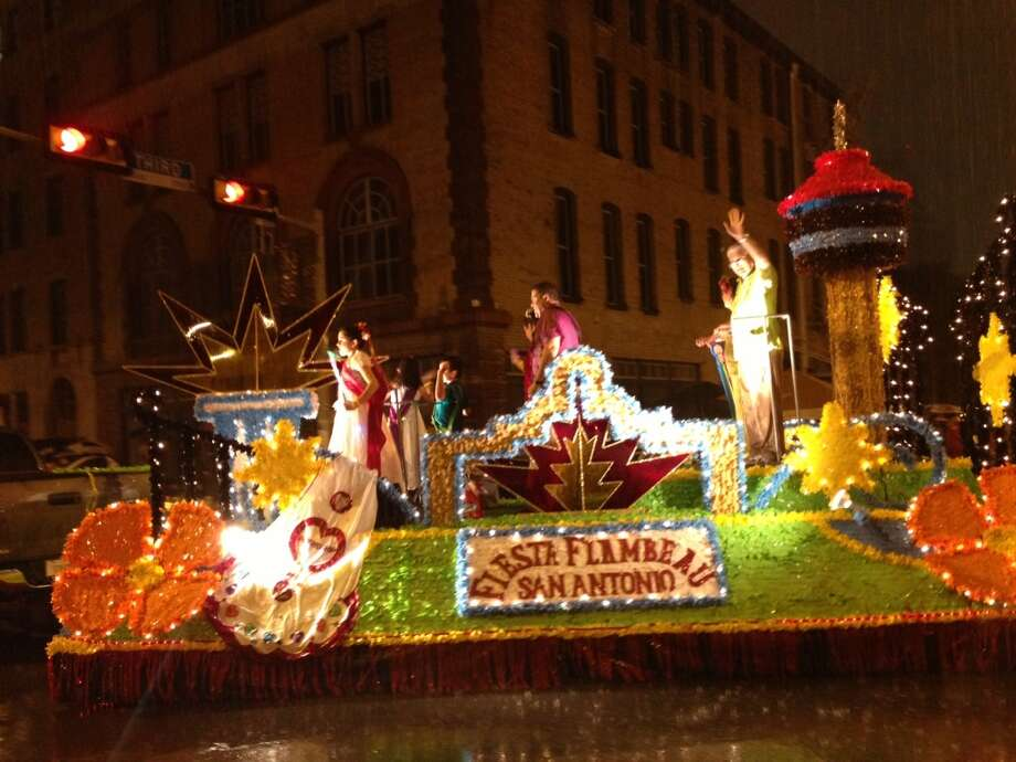 A float braves the rain at the Fiesta Flambeau Parade on Saturday night, April 27, 2013.