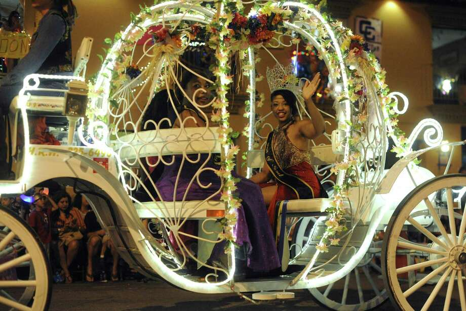 Queen of Soul Brittany Thompson waves from her carriage during the Fiesta Flambeau Night Parade on Saturday, April 27, 2013. Photo: Billy Calzada, San Antonio Express-News / © 2013 San Antonio Express-News