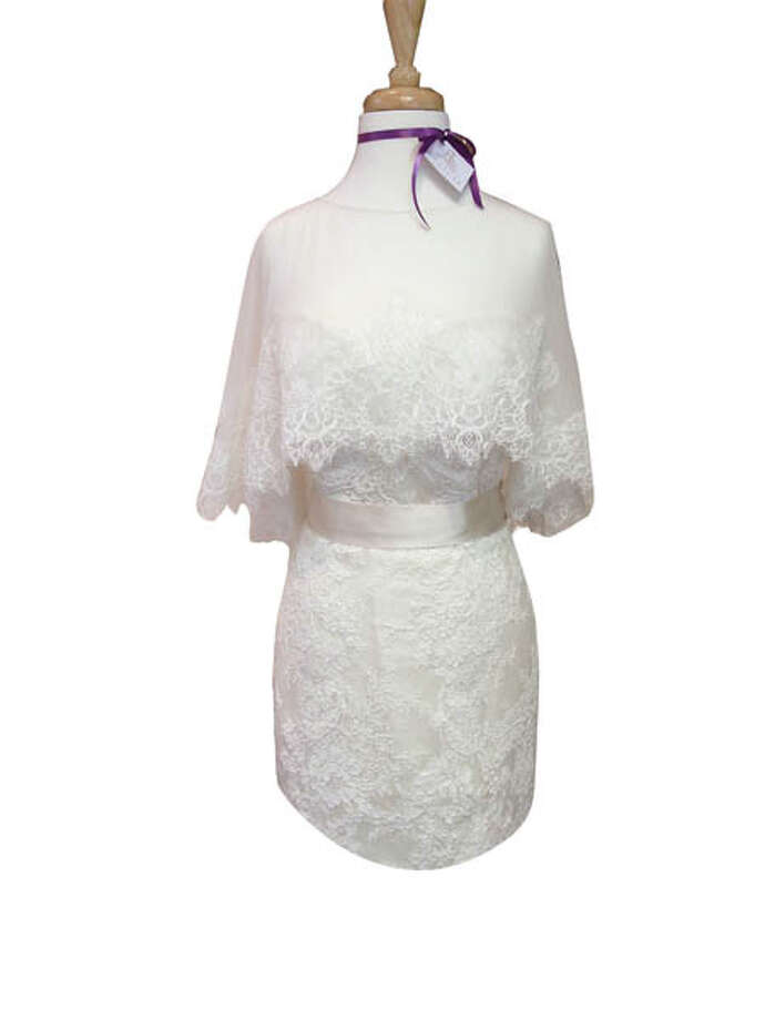 A Cape to Remember Soft, over-the-shoulders shawl-capes give winter-wedding brides a soft, cozy, elegant look. This one comes with white, fluttery lace. Get it at Angela's Bridal  in Albany.