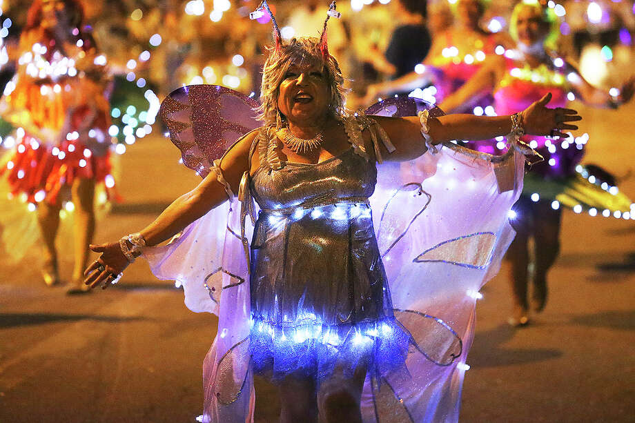Kazamba dancers stir up the crowd on Broadway as the Flambeau Parade moves toward the downtown area  on  April 27 2013. Photo: TOM REEL, San Antonio Express-News