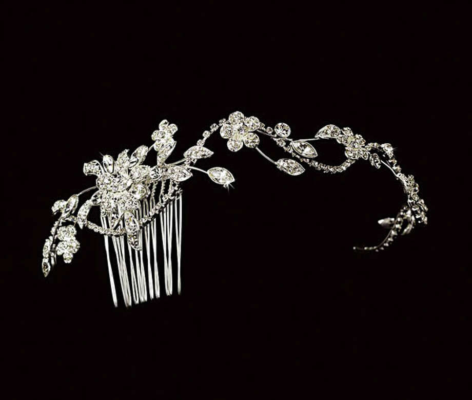 Comb It Out You can never have too much sparkle on your wedding day. Dress up any wedding hairstyle with this antique silver comb. Made of freshwater pearls, Swarovski crystals and rhinestones, it will add simple elegance to any bride's style. Get this hair comb at Clifton Park-based