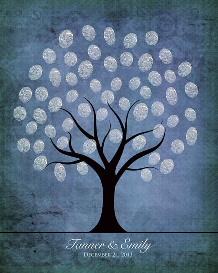 "Guestbook 3.0A nice variation on a guestbook, this wintry tree collects the fingerprints of your guests. The result is a blossoming tree of white fingerprint-leaves. Hang it in your home after the wedding as an arty tolkien of your greatest day. Comes in different sizes; a 16x20 sheet holds about 175 ""signatures."" $14.75 at Amber Sue Photography's"