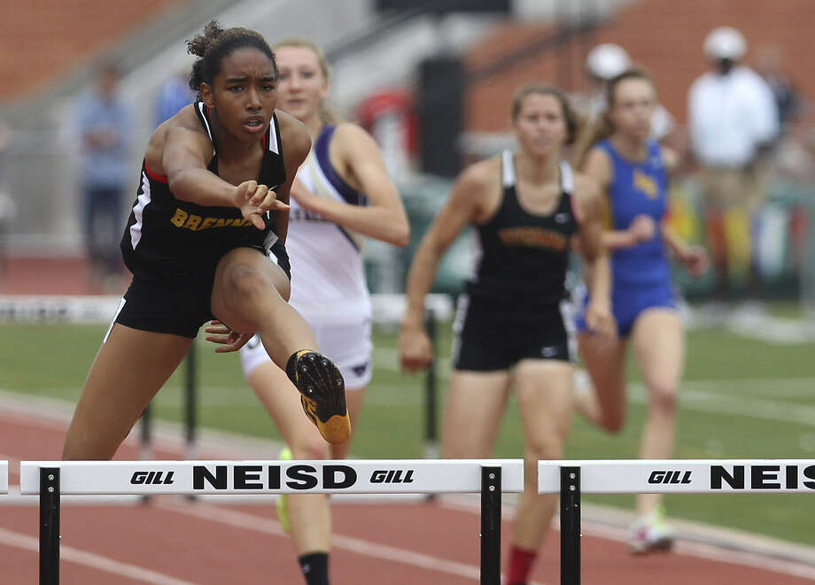 Brennan's Autymn Scales clears the final hurdle en route to winning the 300-meter hurdles in the Region IV-4A track meet at Heroes Stadium. Photo: Kin Man Hui / San Antonio Express-News