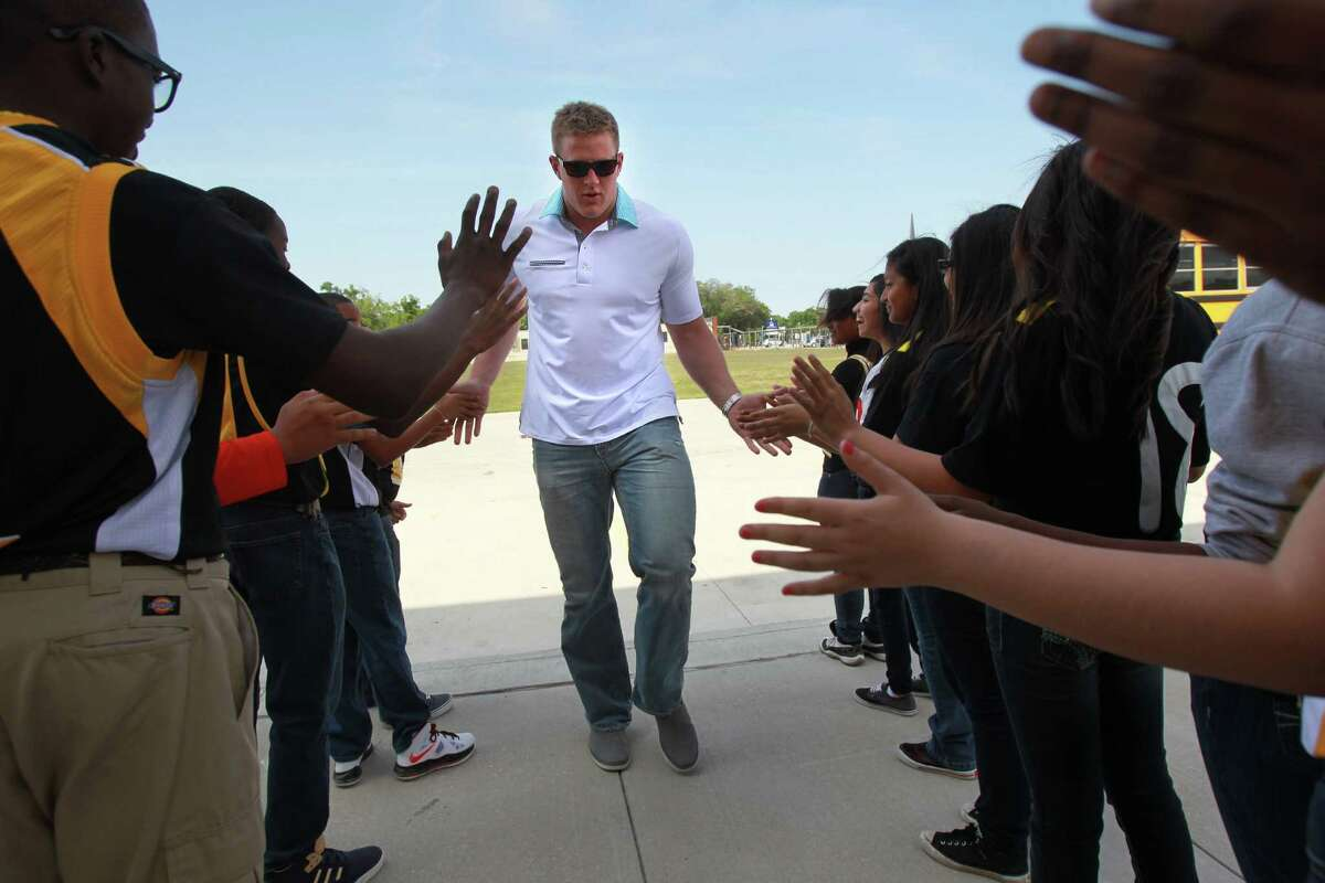 KIPP Liberation College Preparatory School students line up to greet J.J. Watt on Thursday after his foundation donated $60,000 for athletic equipment.