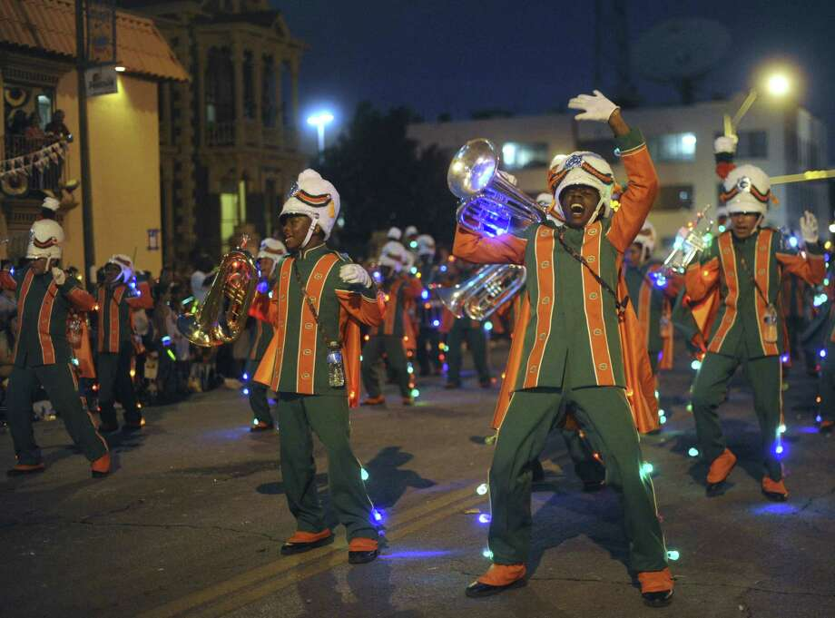 The Sam Houston High School marching band. Photo: Billy Calzada / San Antonio Express-News