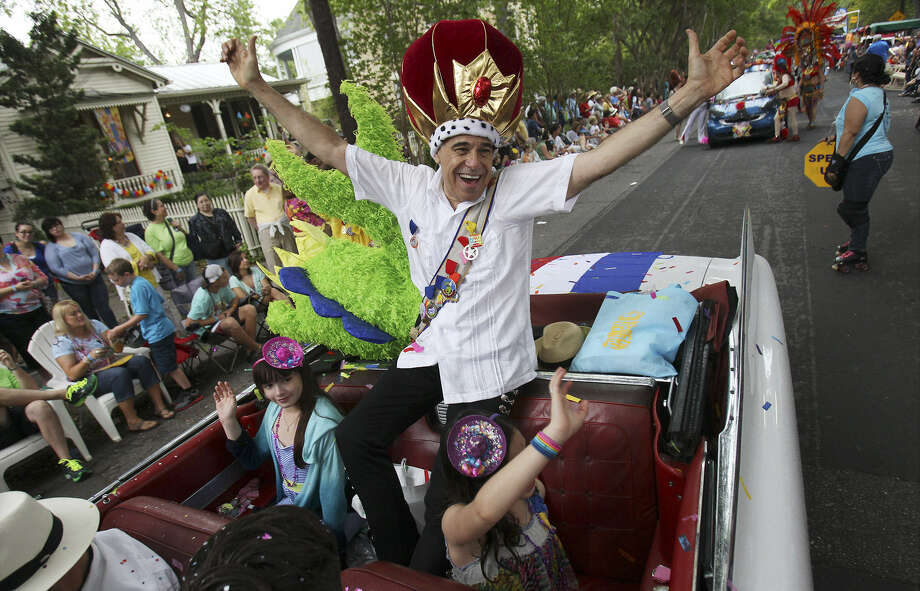King Anchovy Charlie Gonzalez acknowledges the crowd at the King William Parade on Saturday. After the parade, thousands hit the food and craft booths at the annual event. Photo: Kin Man Hui / San Antonio Express-News