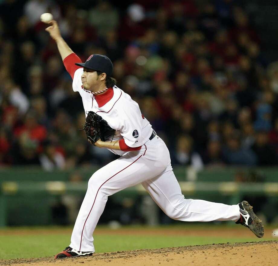 Boston reliever Junichi Tazawa struck out one and walked one in 1/3 of an inning. Photo: Michael Dwyer / Associated Press