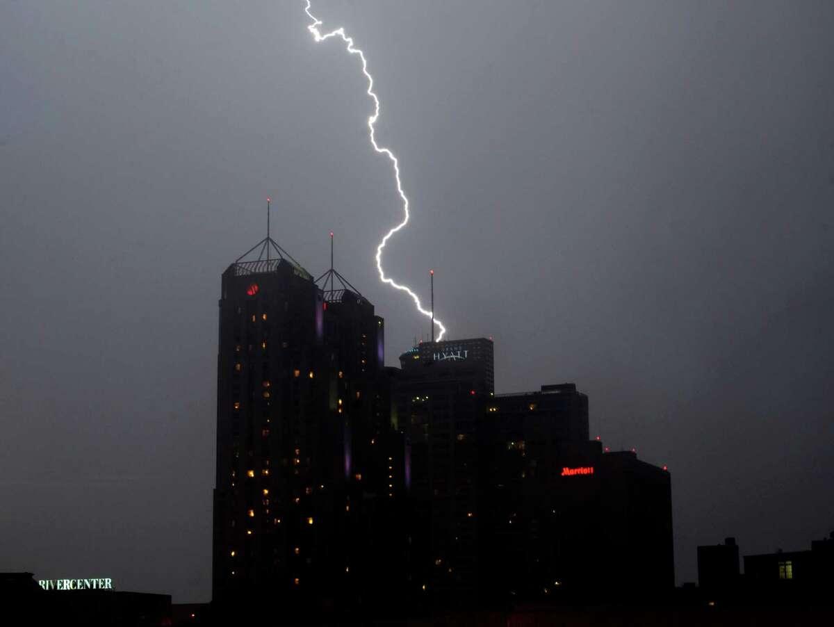 Lightning strikes over downtown San Antonio after the Fiesta Flambeau Night Parade on Saturday, April 27, 2013.