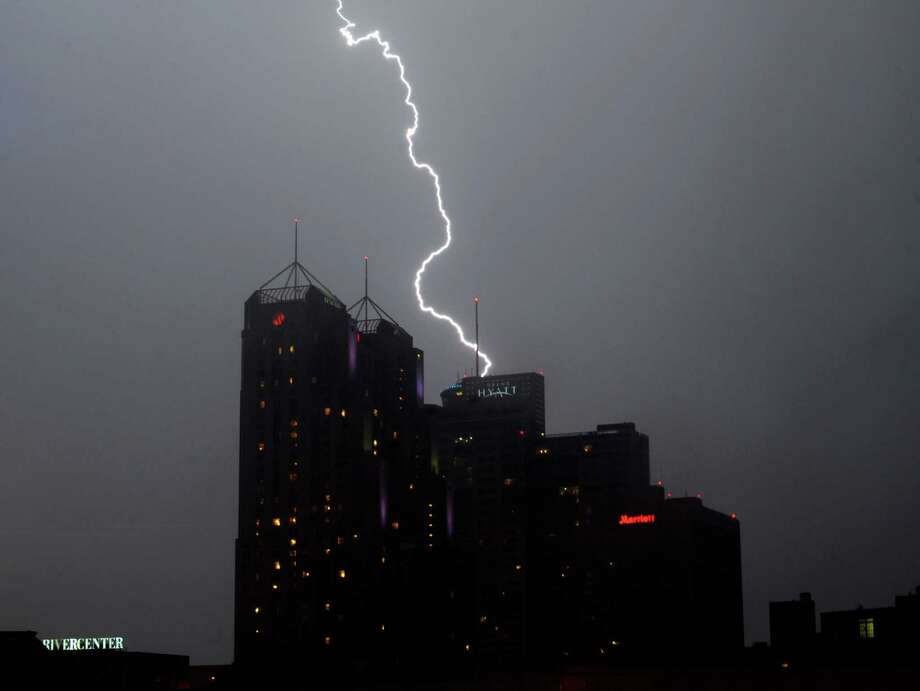 Lightning strikes over downtown San Antonio after the Fiesta Flambeau Night Parade on Saturday, April 27, 2013. Photo: Billy Calzada, San Antonio Express-News / © 2013 San Antonio Express-News