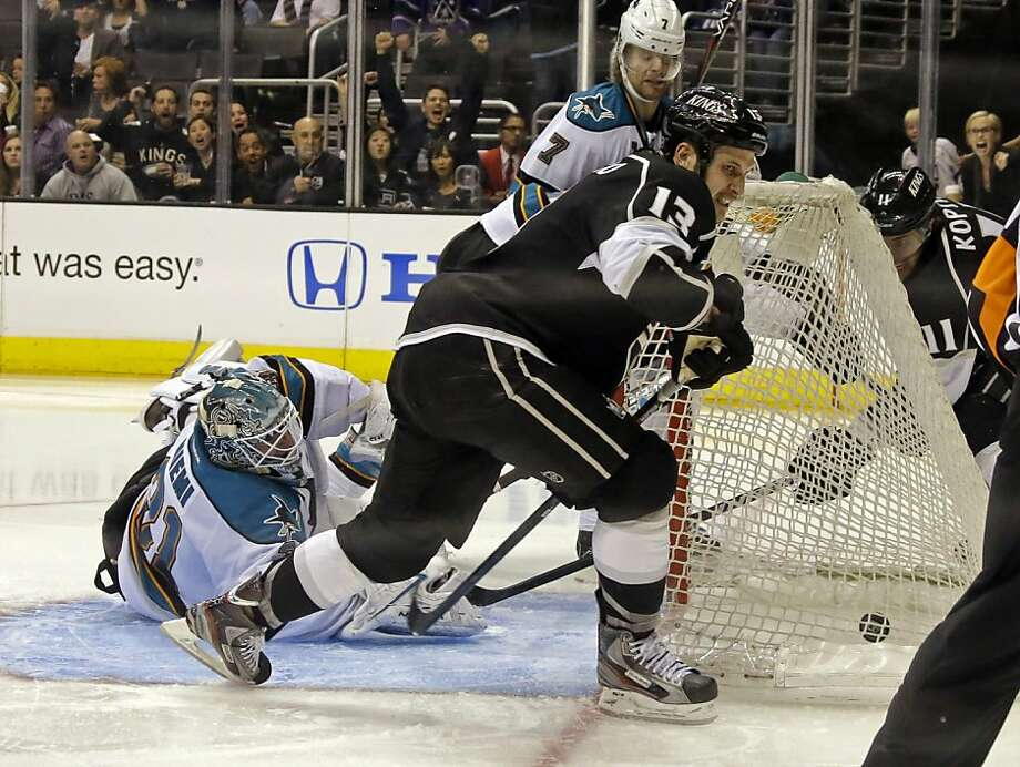 Sharks goalie Antti Niemi watches a goal by Kings' Dustin Penner (not shown) hit the back of the net. Photo: Reed Saxon, Associated Press