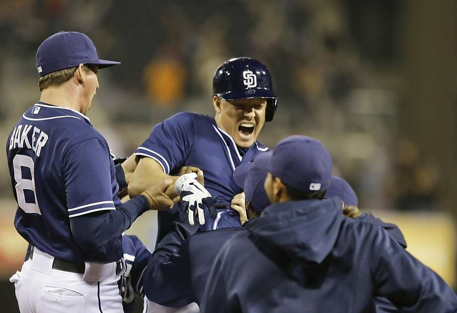 The Padres' Nick Hundley (center) drove in the winning run in the 12th. Photo: Lenny Ignelzi, Associated Press