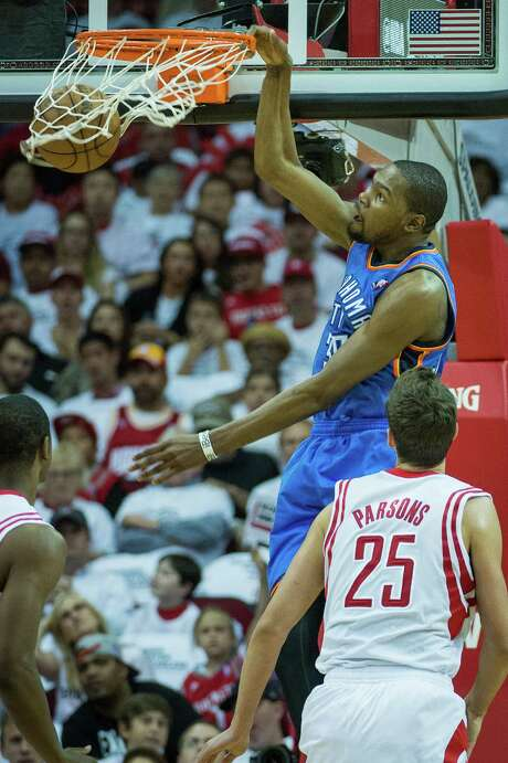 Thunder forward Kevin Durant slams home two of his game-high 41 points Saturday night at Toyota Center. He later hit a key 3-pointer to erase a Rockets lead. Photo: Smiley N. Pool, Staff / © 2013  Houston Chronicle