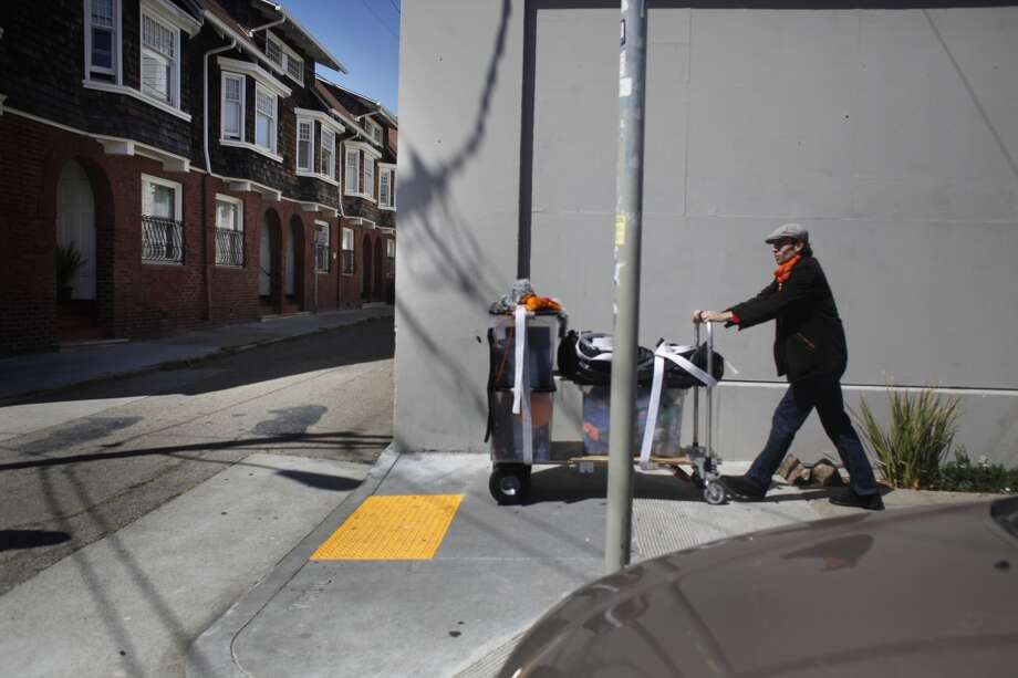 Puppeteer Nick Jones pushes his Flat Broke Puppets Co.  through the Mission in San Francisco.
