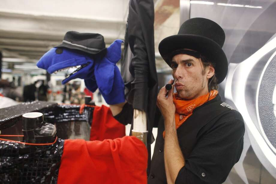 Puppeteer Nick Jones performs his Flat Broke Puppets Co. in the Powell Street BART station in San Francisco.