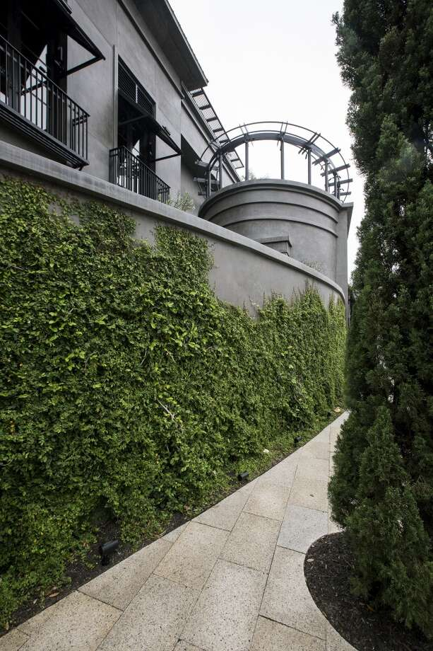 A view of foliage wrapping around the Restoration Hardware building is seen, Wednesday, April 17, 2013 at Highland Village shopping center in Houston, Texas. (TODD SPOTH / FOR THE CHRONICLE)