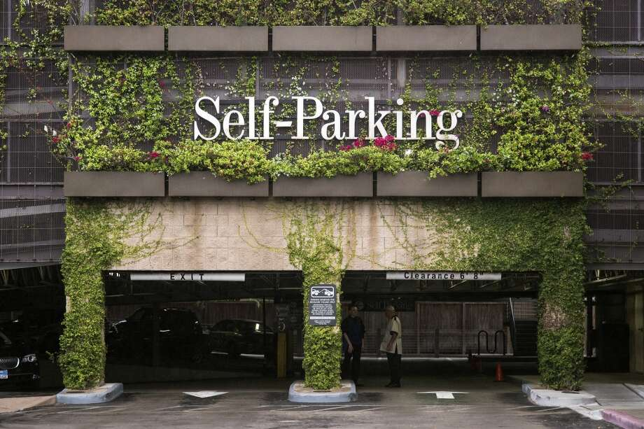 A view of the foliage-covered parking garage is seen, Wednesday, April 17, 2013 at Highland Village shopping center in Houston, Texas. (TODD SPOTH / FOR THE CHRONICLE)