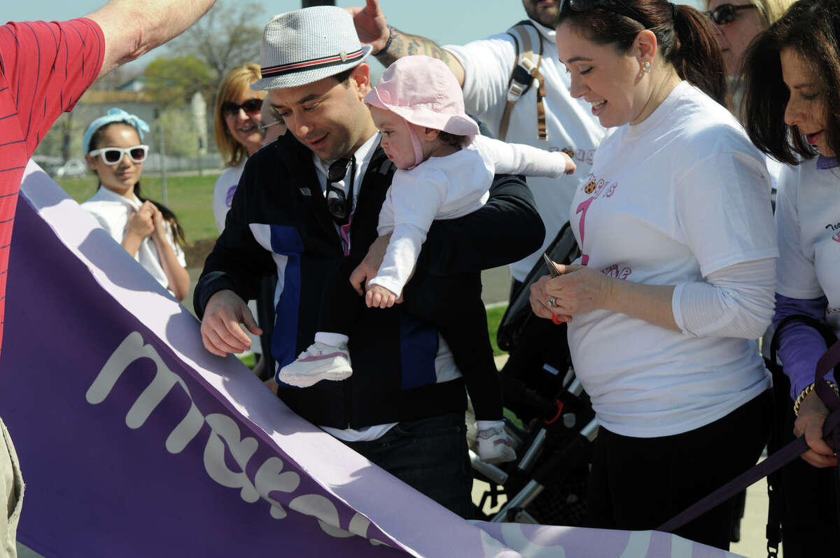 Keith and Michelle Sklar and their daughter Zoey cut the start ribbon as they serve as the ambassador family at the March for Babies, the March of Dimes march for babies, which kicked off at Commons Park in Stamford Conn., April 28, 2013. Zoey was born 15 months ago, five weeks earlier than expected, weighing 4 pounds 14 ounces. She spent 33 days in the Neonatal Intensive Care Unit at Greenwich Hospital where she received specialized care.