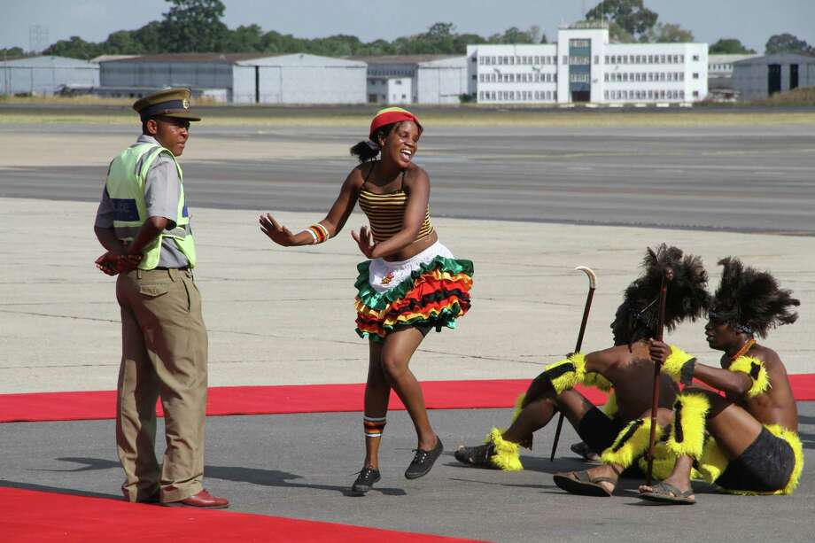 A traditional dancer performs while waiting for the arrival of Malawian President Joyce Banda at Harare International airport in Harare, Tuesday, April, 23, 2013. Banda is on  her first official visit to Zimbabwe  and is set to open  the Zimbabwe International trade fair in Bulawayo. Photo: AP