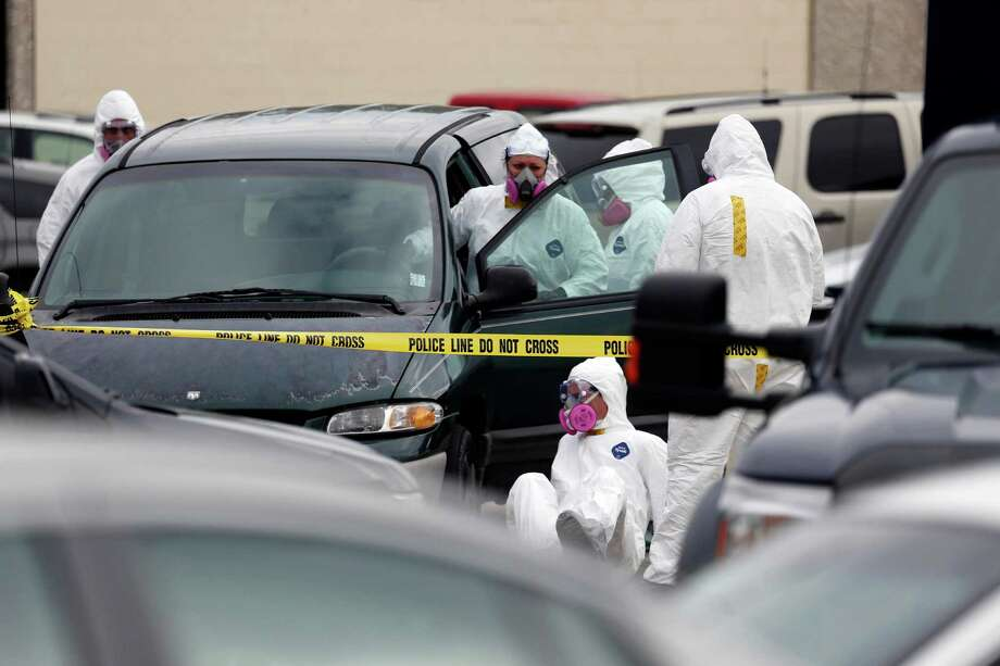 Federal agents inspect the Dodge Grand Caravan driven by Everett Dutschke near the site of a martial arts studio he once operated, Wednesday, April 24, 2013 in Tupelo, Miss., in connection with the investigation into poisoned letters mailed to President Barack Obama and others. Dutschke has not been arrested or charged. Photo: AP