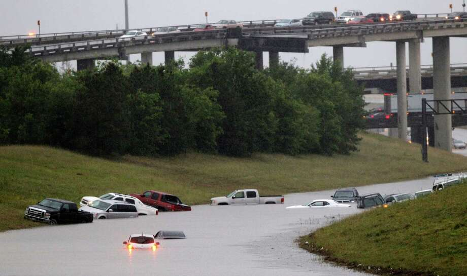 Cars are stranded on 288 at the 610 loop,  which became flooded after an afternoon downpour in Southwest Houston, Saturday, April 27, 2013. Photo: AP
