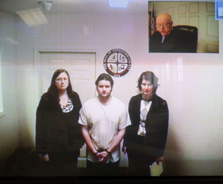 "In this Oct. 15, 2012 file photo, Seth Mazzaglia, bottom center, appears during his video arraignment from the Strafford County jail in Dover, N.H. to the district court in Dover, N.H.  Court documents released Tuesday April 23, 2013 charge Mazzaglia of Dover with killing 19-year-old Elizabeth ""Lizzi"" Marriott during an attempted sexual assault on Oct. 9. Photo: AP"