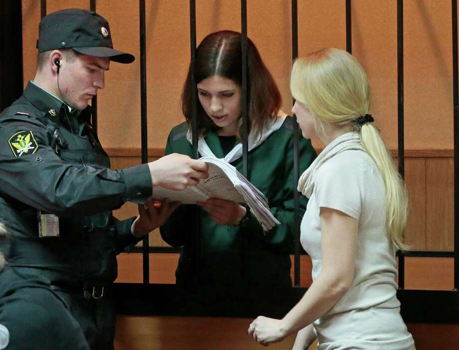 Nadezhda Tolokonnikova, a member of the feminist punk band, Pussy Riot, reads papers at a district court in Zubova Polyana 440 km southeast of Moscow in Russia's province of Mordovia, Friday, April 26, 2013.  Photo: AP
