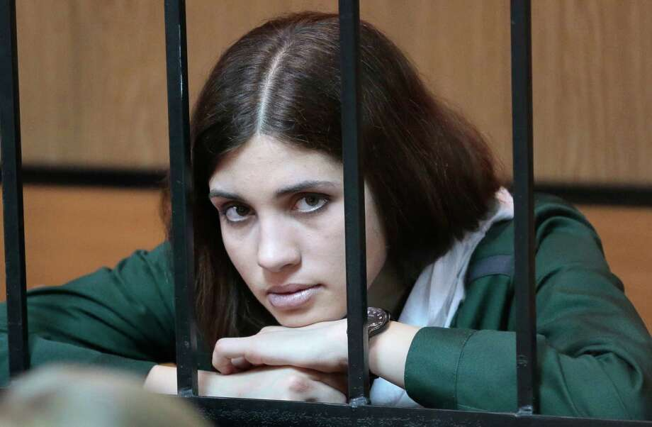 Nadezhda Tolokonnikova, a member of the feminist punk band, Pussy Riot, listens from behind bars at a district court in Zubova Polyana 440 km Southeast of Moscow in Russia's province of Mordovia, Friday, April 26, 2013.  Photo: AP