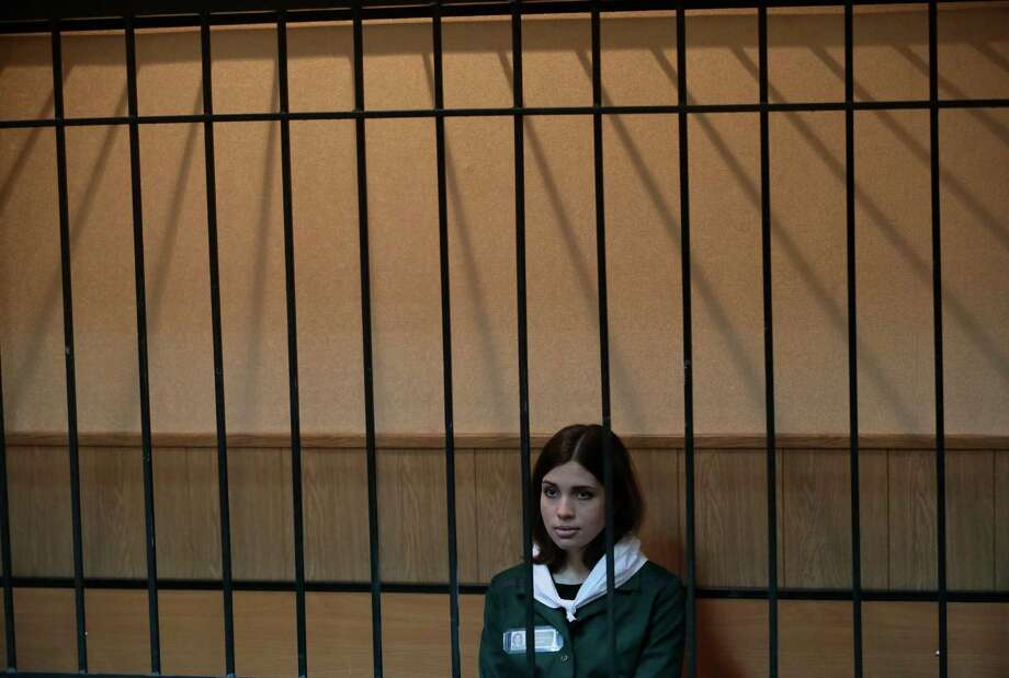 Nadezhda Tolokonnikova, a member of the feminist punk band, Pussy Riot, sits behind bars at a district court in Zubova Polyana 440 km southeast of Moscow in Russia's province of Mordovia, Friday, April 26, 2013.  Photo: AP