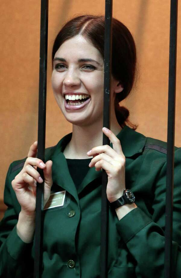 Nadezhda Tolokonnikova, a member of the feminist punk band, Pussy Riot, smiles at a district court from behind bars in Zubova Polyana 440 km southeast of Moscow in Russia's province of Mordovia, Friday, April 26, 2013. Photo: AP
