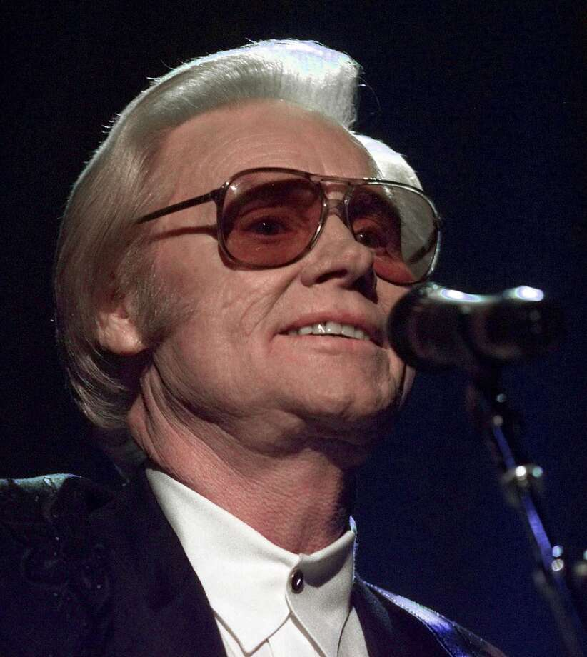 "In this June 1, 1999 file photo, Country music legend George Jones is shown during a performance in Nashville.  Jones, the peerless, hard-living country singer who recorded dozens of hits about good times and regrets and peaked with the heartbreaking classic ""He Stopped Loving Her Today,"" has died. He was 81. Jones died Friday, April 26, 2013 at Vanderbilt University Medical Center in Nashville after being hospitalized with fever and irregular blood pressure, according to his publicist Kirt Webster. Photo: AP"
