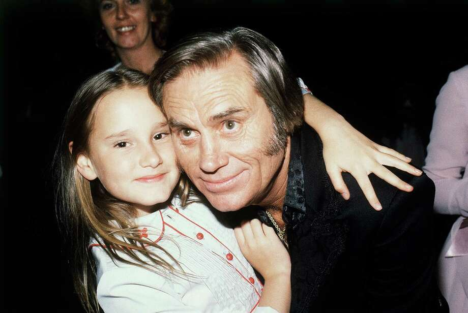 "In this April 30, 1981 file photo, Country singer George Jones, winner of top male vocalist award at the Academy of Country Music Awards, poses with his daughter Georgette, in Los Angeles, Calif.   Jones, the peerless, hard-living country singer who recorded dozens of hits about good times and regrets and peaked with the heartbreaking classic ""He Stopped Loving Her Today,"" has died. He was 81. Jones died Friday, April 26, 2013 at Vanderbilt University Medical Center in Nashville after being hospitalized with fever and irregular blood pressure, according to his publicist Kirt Webster. Photo: AP"