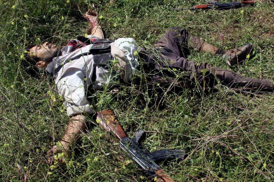 In this Tuesday, April 23, 2013 file photo, the body of a gunman killed during clashes with Iraqi security forces lies on the ground in Hawija, 150 miles (240 kilometers) north of Baghdad, Iraq, Tuesday, April 23, 2013. A shadowy militant group linked to the highest-ranking member of Saddam Hussein's regime still at large could be among the beneficiaries of the unrest that erupted this week in Iraq and is posing perhaps the gravest challenge for Iraq's stability since U.S. troops left. The Army of the Men of the Naqshabandi Order, which takes its name from the mystical Sufi sect, has long been active in the restless northern lands where much of the violence occurred and boasts itself that it was behind several attacks in recent days. Photo: AP