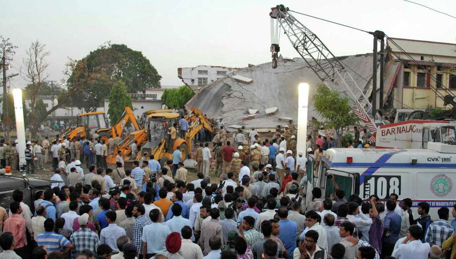 Rescuers work at the site of a building that collapsed in Bhopal, India, Friday, April 26, 2013. A portion of Kasturba Gandhi Hospital building collapsed in central India on Friday and up to 15 people were feared trapped in the debris, an official said. Photo: AP