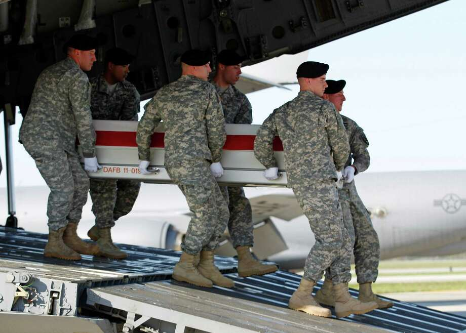 An Army carry team carries the transfer case containing the remains of Army Capt. Aaron R. Blanchard of Washington, upon arrival at Dover Air Force Base, Del. on Thursday, April, 25,  2013. The Department of Defense announced the death of Blanchard who was supporting Operation Enduring Freedom in Afghanistan. Photo: AP