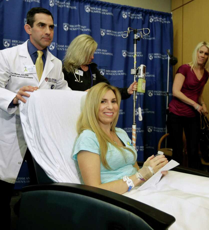 Heather Abbott, of Newport, R.I., center, is pushed by Orthopedic surgeon Eric Bluman, left, as they depart a news conference at Brigham and Women's Hospital, in Boston, Thursday, April 25, 2013. Abbott underwent a below the knee amputation during surgery on her left leg following injuries she sustained at the Boston Marathon bombings on April 15. Photo: AP